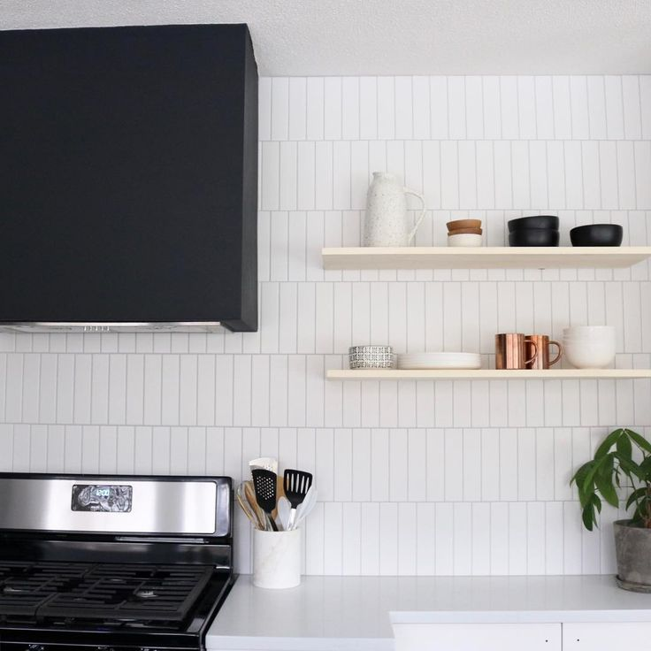 Vertical Offset Subway Tile With Black Hood Vent And