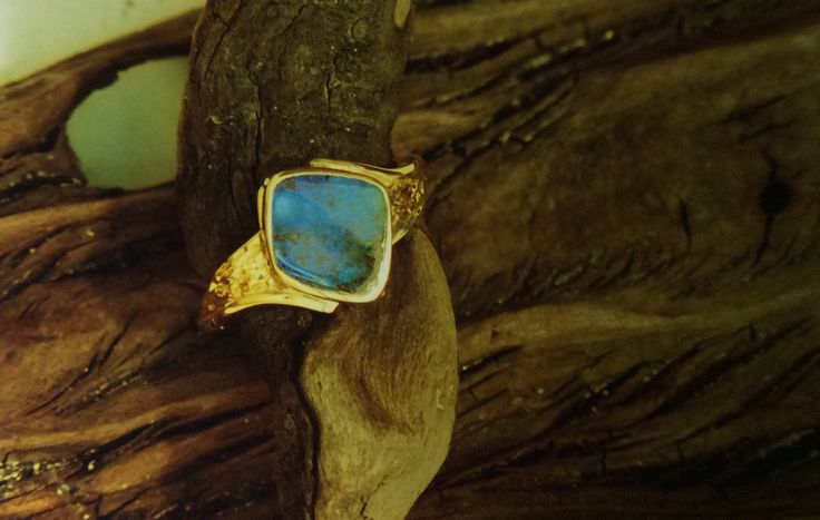 Boulder opal rim set wit deep texturing to the band