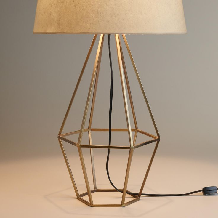 Warm Brass Finish And An Open Diamond Shaped Design Our Mid Century Style Table Lamp Adds A Unique Geometric Presence To Any Room Top It With Of