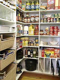 What could be more beautiful than a well stocked and highly organized pantry? This well-designed space is filled with a multitude of cubbies for canned and dry goods. Baskets offer quick access to kitchen utensils and other daily kitchen supplies. Notice the narrow slots, bottom right. They are the right size for frying pans and cookies sheets. No space of this room is left unused.