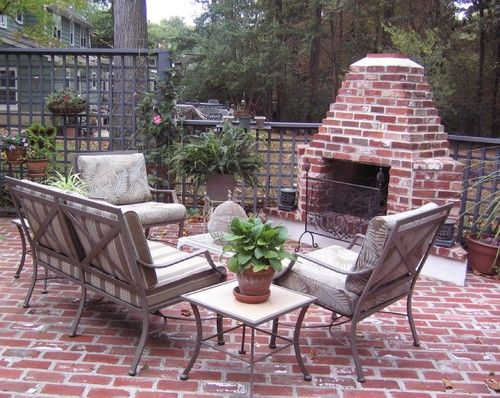 This is a gorgeous brick courtyard area that features intriguing patio furniture to match. A common theme within these brick patio design ideas, a fireplace is a fantastic element to bring people together in a sitting area. Of course, you'd need to plan a brick fireplace in an area where it gets cold enough to use it, as I can't imagine a fireplace would be that enjoyable in places with hotter climates.