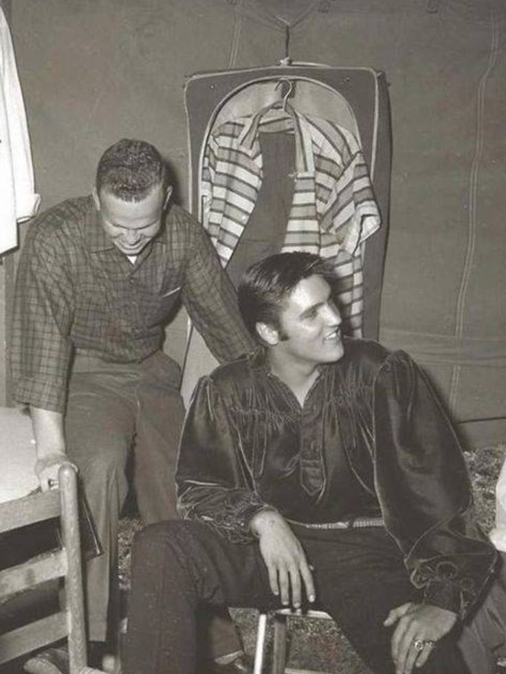 """This photo of Elvis in his dark blue velvet shirt with former Tupelo class mate Joe """"Bitsy"""" Savery was taken by photographer Terry Wood in a dressing room tent at the fairgrounds in Tupelo, MS on Wednesday, September 26, 1956 before his first show. Elvis returned to Tupelo to perform two shows at the Mississippi-Alabama Fair and Dairy Show that day. Elvis Presley Day was proclaimed in Tupelo, Mississippi on September 26, 1956."""
