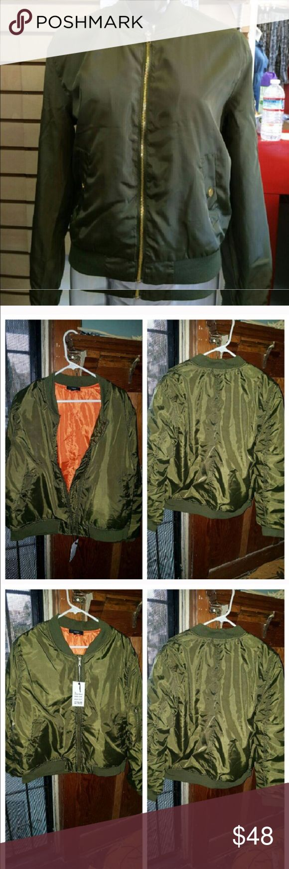 USAF Style Military Bomber Jacket Plus Size Orange lining pockets all over this must have jacket is now in plus size 1X, 2X and 3X. It's nylon and very durable along with stylish. We love it and wear it everywhere. You will too. Jackets & Coats