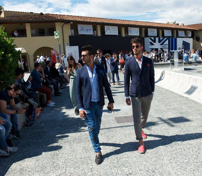 Fashion-forward men at the trade fair in Florence reflected a new clothing style: Snug trousers, a fitted blazer, shoes with proper hard soles and an assertive color palette.