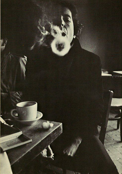 A patron enjoying Paloma's gypsy cave cafe, Esperanza, Granada, 1978