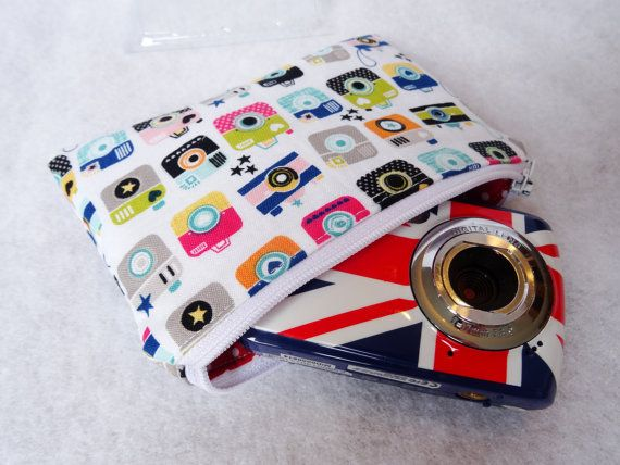 Gorgeous padded zippered camera pouch made from retro camera fabric. The camera pouch is stylish and functional. It is the perfect size to fit any