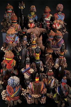 Africa | Collection of dolls from the Kirdi / Fali people of northern Cameroon | Wood, glass beads, leather, shells, metal, fiber and coins