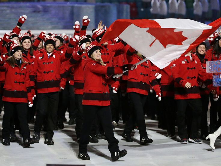 Team Canada in red and black duffle coats with a hip stripe and all the other #Sochi Olympics opening ceremony looks of the Parade of Nations