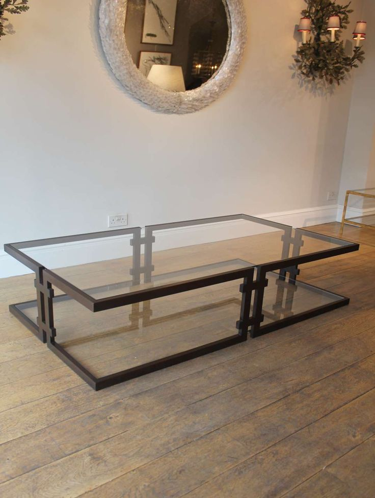 Bronzed steel framed cantilevered coffee table.