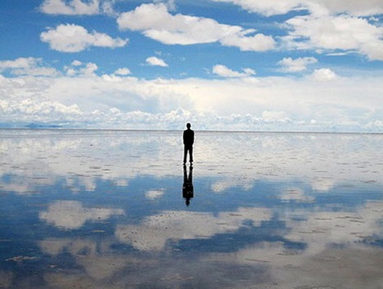 The Salar de Uyuni in Bolivia. The result of the convergance of a few prehistoric lakes that, over millennia, dried to leave a single salt pan over a metre thick, the Salar de Uyuni covers well over 4,000 square miles. That's twenty-five times the size of Utah's own (far more famous) salt flats, which is proof that a good publicist is worth her weight in gold.