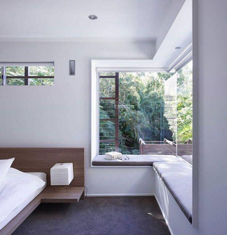 a window seating for corner window sunroom