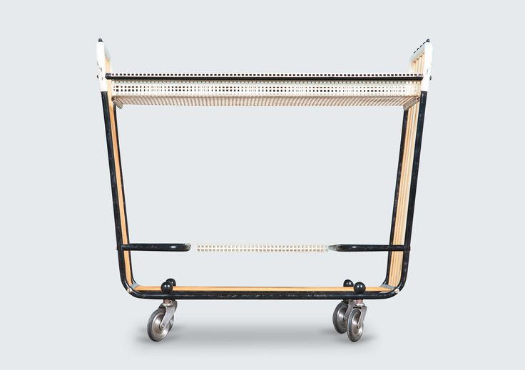 A rare piece with character. This is a Mathieu Mategot inspired drinks trolley produced by Pilastro, Holland in the 1950s. Made from tubular and perforated metal with decorative lacing. Very cool.