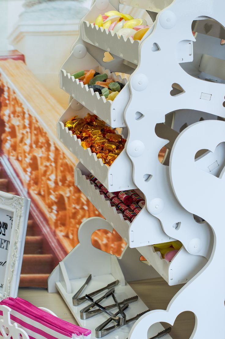 If you are looking for something that is both amazing and practical to add to your wedding table, party or event then look no further than our Candy Cart Ferris Wheel.  Our Ferris wheel measures 90cm wide x 90cm high (3 feet x 3 feet approx) and is manufactured from food grade white plastic.  The revolving wheel has has sixteen individual swinging trays, each capable of holding in excess of 1kg of sweets (20kg of sweets can be provided).  Available for hire in Hampshire area.