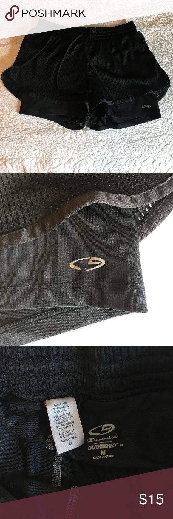 Champion duo dry shorts size m Black on black champion duo dry workout shorts with spandex under layer. Size medium. Wore once for maybe an hour and discovered my attempt at being a shorts wearing girl was pointless. Washed and line dried but the emblem started to peel already. Other than that, they are practically new without tags. Champion Shorts