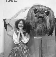 ever want to see art that is both dark and beautiful , venture into a surrealist dream state of infinite possiblities , look upon the odd , the curiosity , then this freaky picture of the late surrealist artist dorothea tanning next to a giant sized sculpture of a dog shows you should take a look at her  dorothea tanning