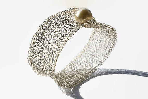 A shiny and elegant silver wire #crochet bangle bracelet with a large pearl decorating it. It is crocheted with  a rare traditional technique.   I used Silver Plated Artisti... #handmade #jewelry #boho #etsy #epiconetsy #shopping #shopsmall #jewelryonetsy #etsyseller