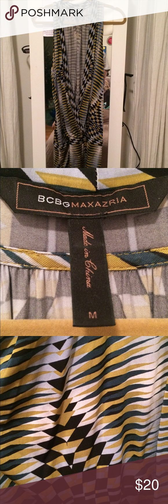 BCBG Max Azria going out top Low cut tank top with a long band on the bottom. BCBGMaxAzria Tops Tunics