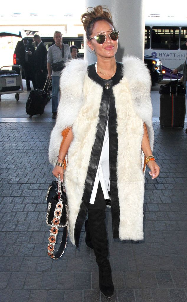 Adrienne Bailon rocks a white fur coat and round flash lens sunnies with an elevated brow bar. How posh!