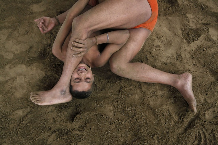 "Wrestlers fight at a permanent mud wrestling ring at ""Sia Ram bhajan samati akhaara"", a traditional Indian wrestling training centre, on the banks of the river Ganges in Kolkata February 17, 2013. India's government will seek the support of other countries where wrestling is popular to help the sport remain an Olympic discipline, the country's sports minister said on Wednesday. REUTERS/Rupak De Chowdhuri: Rivers Gang, Sports Stars, February 12, Sports Remain, News India, February 17, Photo Galleries, Country Sports, Sports Minist"