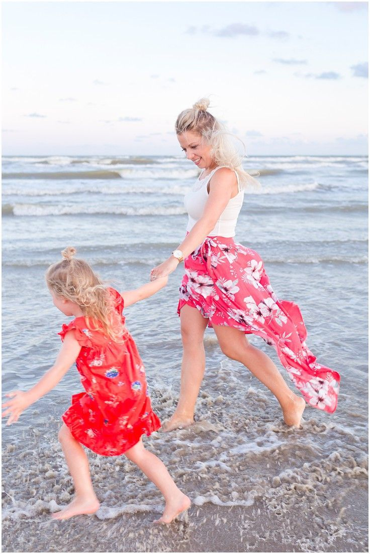 Mom And Daughter Playing At Galveston Beach During Family Vacation