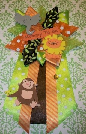 Jungle/Safari Corsage at  http://www.modern-baby-shower-ideas.com/safari-baby-shower-theme.html