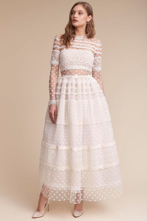 """This Swiss-dot meringue poufof a dress is also called the""""Keaton."""" So you have to get it.   $3,600, bhldn.com."""