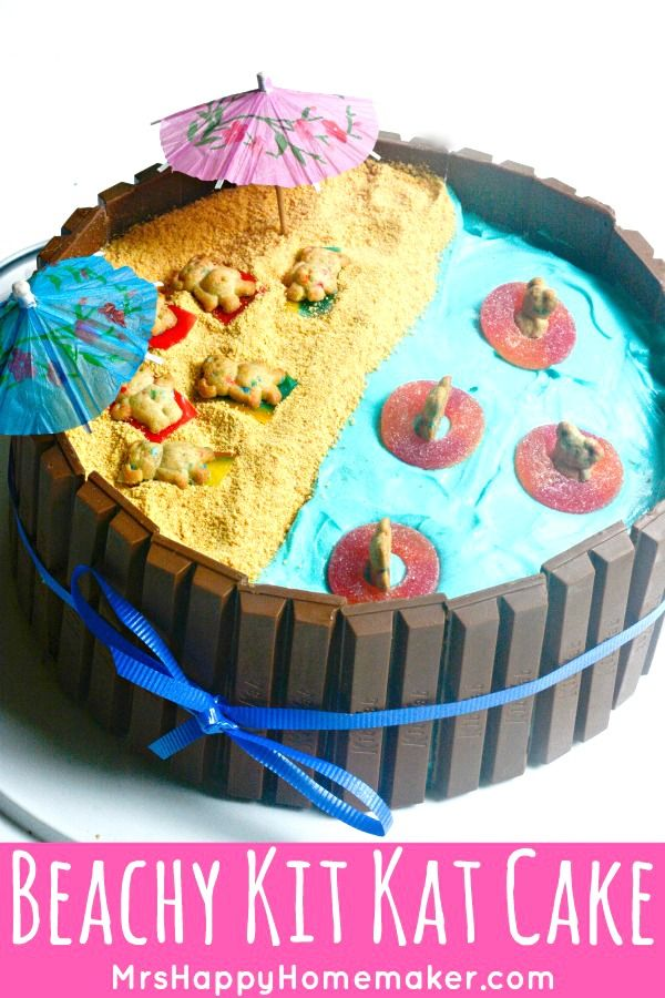 This Beach Scene Kit Kat Cake is the cutest! It's so easy that even people who aren't good cake decorators, like me, can put it together in a jiffy! | MrsHappyHomemaker.com @thathousewife