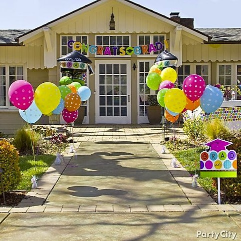 A balloon-lined path gets the grad party started at the front door!