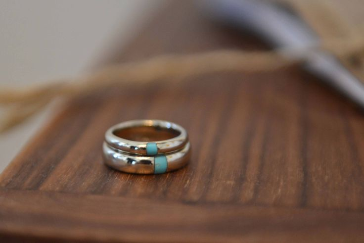 Pamela Love's wedding bands: Matching white gold wedding bands with turquoise inlay designed by Love.