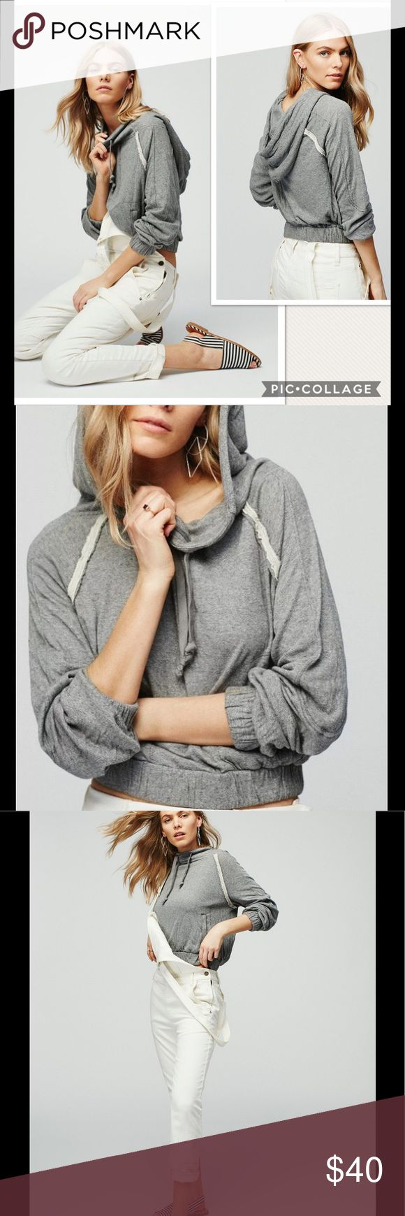 NWT Free People Kimmie Hooded Gray Pullover Top Ribbons of raw-edge gauze mark the raglan sleeves of a comfy-cool hooded pullover, perfectly combining athletic and boho sensibilities. A stretchy waistband and cuffs complete the cozy look.  Funnel neck with drawstring hood. Long sleeves with elastic cuffs. Side slip pockets. 70% cotton, 23% polyester, 7% rayon. Machine wash cold, tumble dry low. Free People Tops