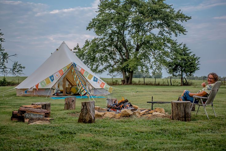 Imagine driving through a vineyard of concord grapes and butterfly gardens to arrive at your campsite overlooking a lovely river valley and rolling hills, entering your spacious bell tent set up with comfy inflatable beds complete with linens and cozy quilts, unique vintage furnishings,