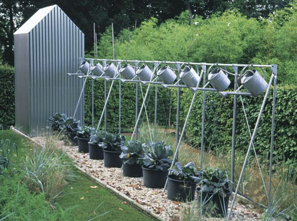 Cool Kitchen Garden Containers. Get some inventive garden ideas here http://www.vegetablegardener.com/item/5434/cool-kitchen-garden-containers