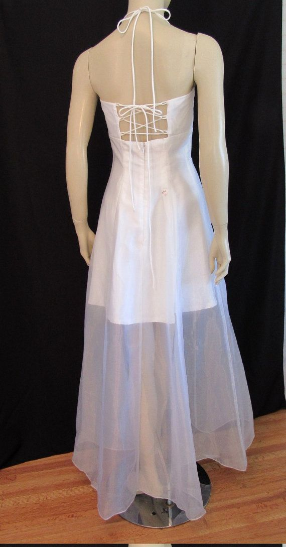 Vintage 90s ZumZum unique Bridal Gown. Gorgeous filmy Juliette style formal with filmy sheer organza overlayer and skirt. The underdress is a pale ivory color, the Organza is white, which gives the gown a delicate cream color. Organza features satin pink rosette & mini bead detail. The underdress is mini length. Other details: Fitted bust, empire waist, lace up back, halter tie at neck. Zip back and tie entry. Fully lined (except for sheer skirt portion) Made in Hong Kong 100% Polyester, ...