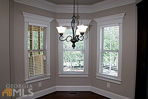 slideshow Like molding around windows/wall color/ pewter chandelier