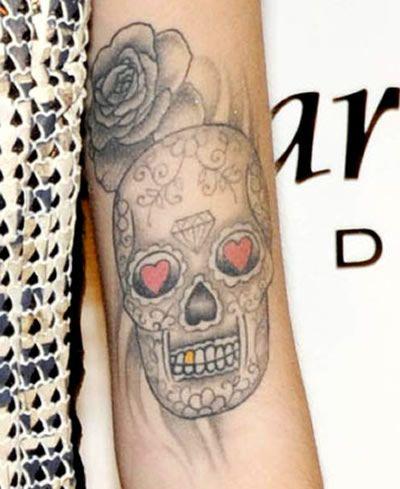 cher loyd skull tattoo   Cher Lloyd's Mexican Sugar Skull and Rose Arm Tattoos
