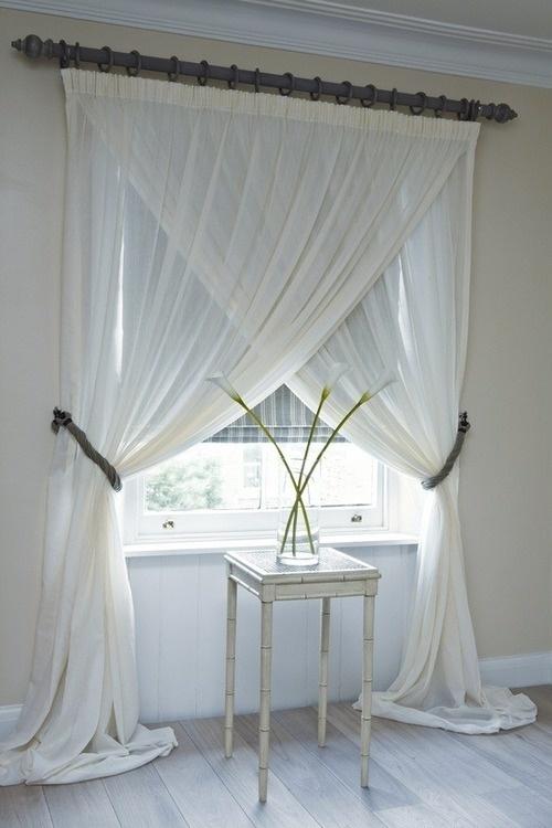 Pretty double layer gauzy window drapery tied back on opposite sides