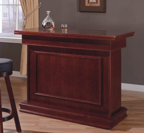 """Cherry Finish All in One Game Table/Bar Unit w/Wine Shelves (Roulette, Blackjack & Craps) by Coaster Home Furnishings. $537.75. Some assembly may be required. Please see product details.. Dimension: 53.25""""W 24.25""""D 40.25""""H Finish: Cherry Material: Wood All in one bar unit. Three different game table setting (Roulette, Blackjack and Craps) Wine rack, glass hangers and shelves behind the unite. The table nicely converts to a wood top when not used or used to serve dri..."""