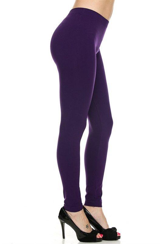 Seamless solid purple leggings. 92% nylon / 8% spandex.