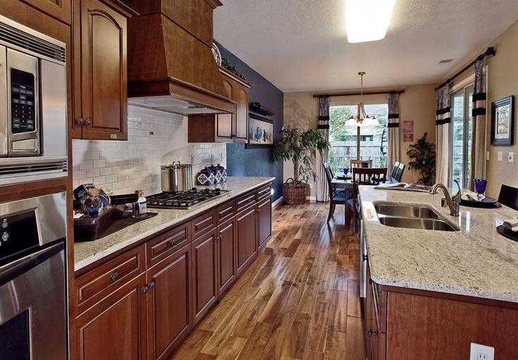 kitchen featuring hand scrapped floors and oiled cabinetry.