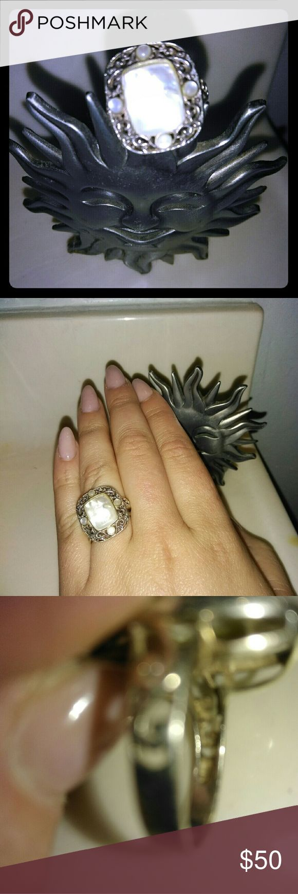 925 Sterling silver mother of pearl ring Beautiful. Don't wear much anymore. In excellent condition. Price is firm. Stamped 925 Jewelry Rings