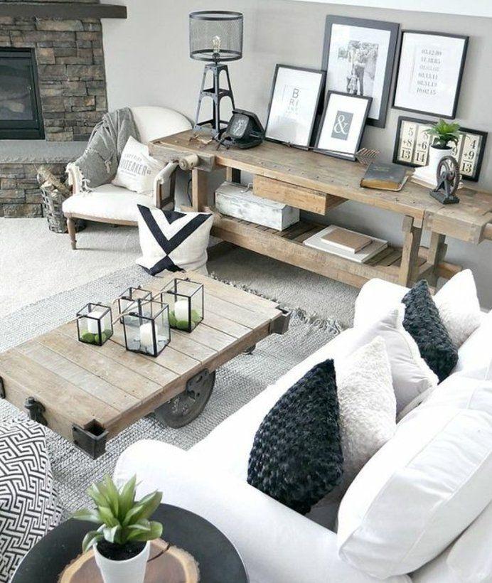 deco-campagne-chic-avec-une-touche-rustique-table-en-bois-à-roulettes-canapé-blanc-cheminée-romantique-table-de-service-en-bois-decoration-cadre-photos