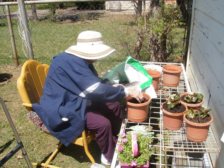 Granny doing what she loved to do best.... work in the yard!!!