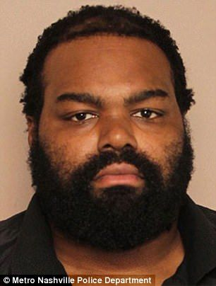 Michael Oher pictured, in mugshot...