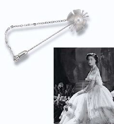 A CULTURED PEARL JABOT PIN Designed as a butterfly, the body set with a single cultured pearl, 6.4 cm. long ~ from the Collection of H.R.H The Princess Margaret, Countess of Snowdon