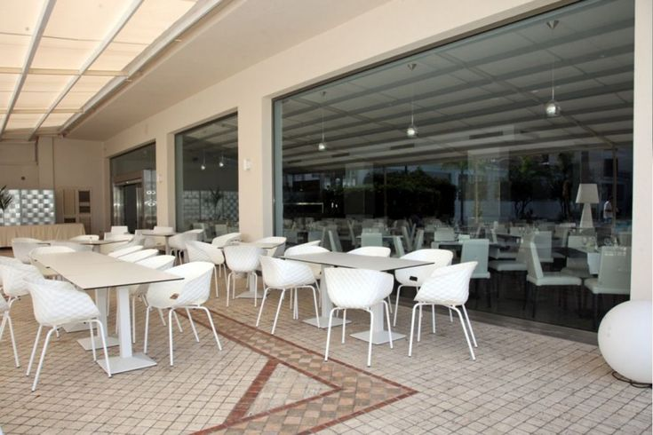 Uni-Ka in white, chairs with padded texture and steel legs at The Hotel Santa Lucia, Cefalu, Italy.    Hospitality, Interior, Design, Furniture, Seating, Dining, Lifestyle, Decor, Restaurant, Hotel, Europe, Travel