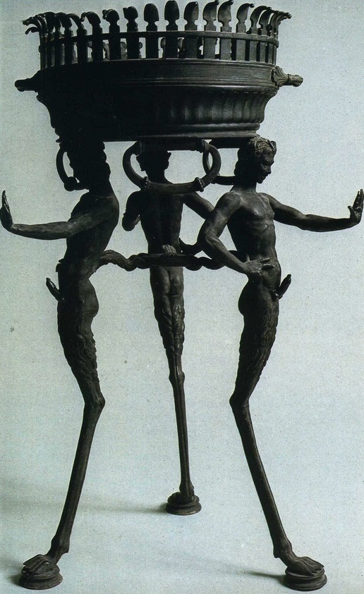 Three slender ithyphallic fauns supporting a basin, found in a house in Pompeii.