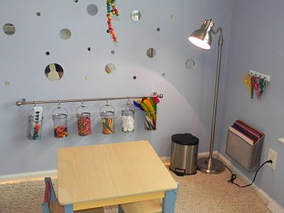 Curtain rod with hooks to hang buckets of art materials from.