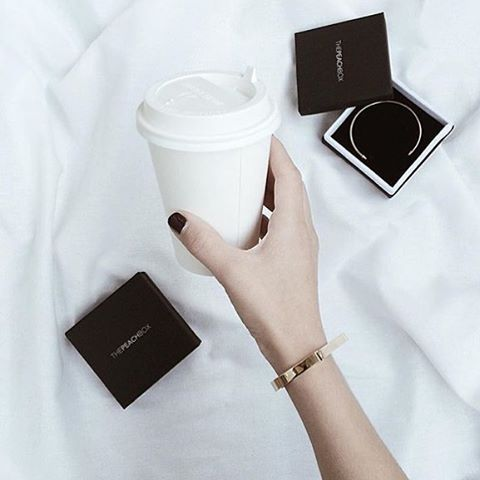 Enjoy a little coffee pick me up to start your Sunday right! Lovely shot of our Gold Screw Bar Bangle and Aztec Warrior Bangle by @sleepnovember! @thepeachbox #thepeachbox #screwbarbangle #aztecwarriorbangle #startyourdayright
