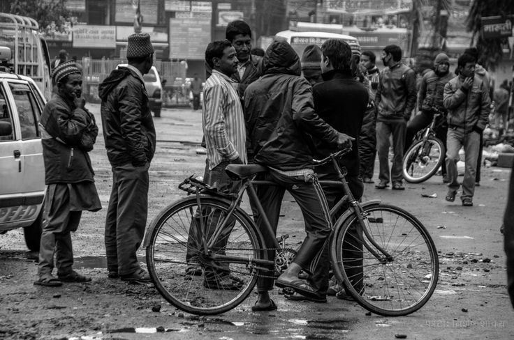 Locals of Pokhara (Nepal) gather on the street for a morning chat with friends.