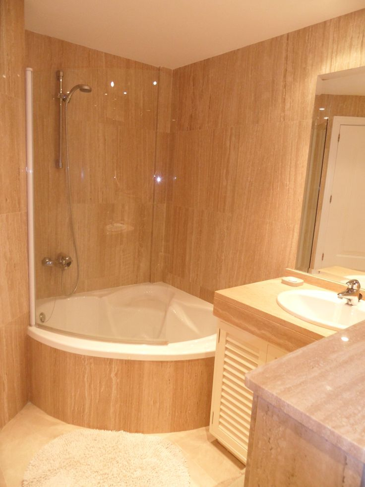 Perfect corner tub with shower and glass half door. Very cool.